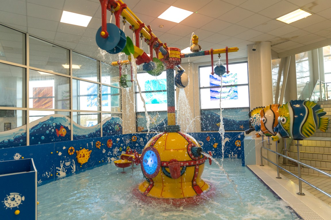 ... Pool For Young Children. The Toddler Play Area Includes A Number Of Fun  Features Such As Fish Spouting Water Jets, Tipping Buckets And Water Wheels.
