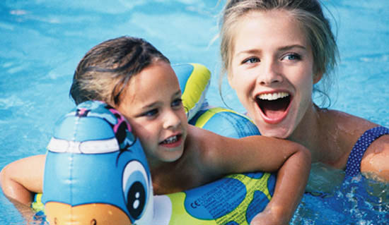 Child in pool with inflatable